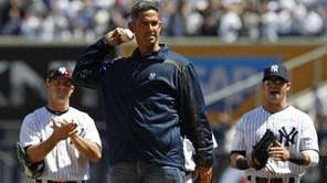 Retired Yankees catcher Jorge Posada throws out the