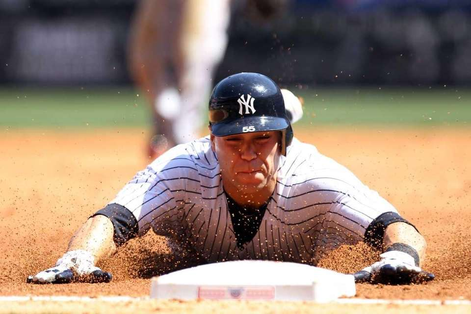 Russell Martin of the New York Yankees slides