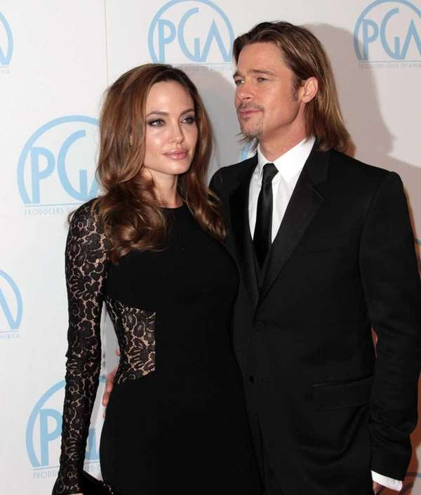 Actress Angelina Jolie and actor Brad Pitt attend