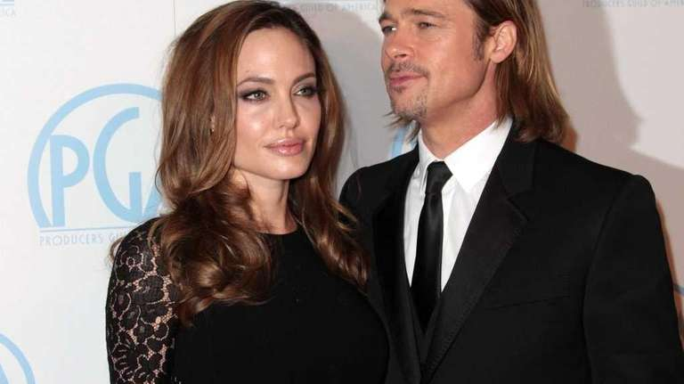 Angelina Jolie and Brad Pitt attend the 23rd