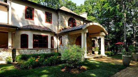 This five-bedroom, six-bath Mediterranean-style home in Oyster Bay