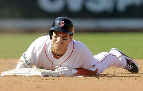 Boston Red Sox' Jacoby Ellsbury reacts after colliding