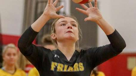 Emma Benes of St. Anthony's sets the ball