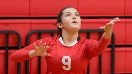 Connetquot's Diana Migliozzi serves during a volleyball tournament