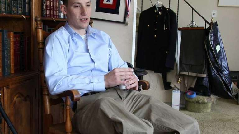 James Byler sits in his home in Huntington,