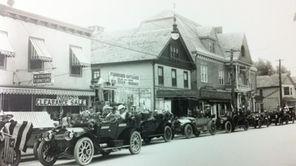 A motorcade goes down Main Street in Bay