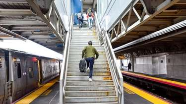 Passengers exit an LIRR train at Jamaica Station