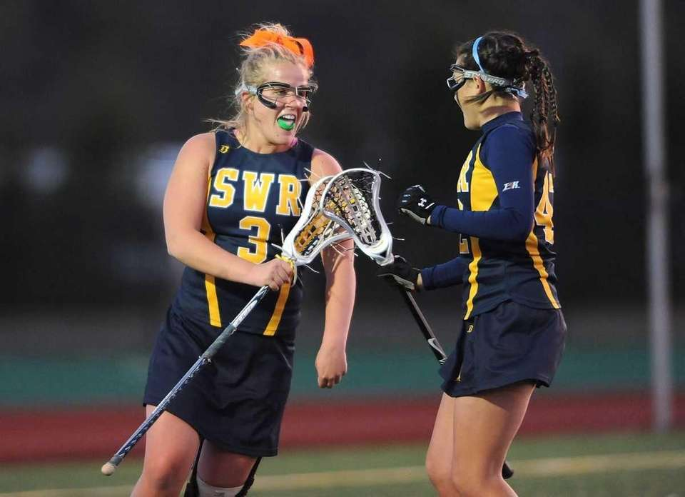 Katie Boden, #3 on Shoreham-Wading River, left, celebrates