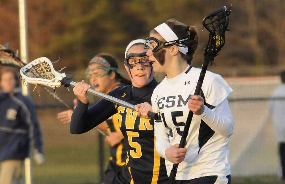 Shoreham-Wading River's #5Jessica Angerman defends Eastport-South Manor's #15