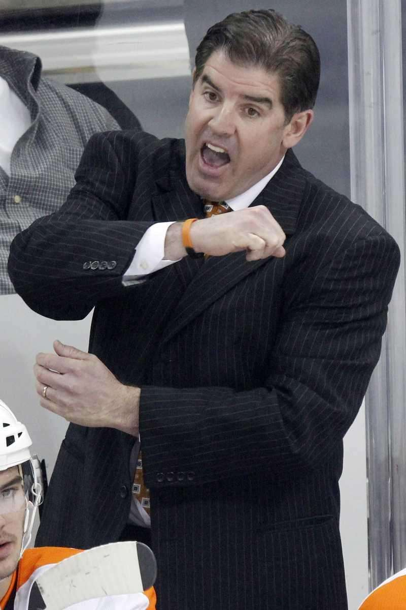 Philadelphia Flyers coach Peter Laviolette gestures to a