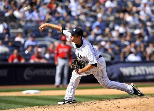 David Phelps pitches in relief of Phil Hughes.