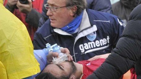 Medics assist Livorno's Piermario Morosini at the Pescara's