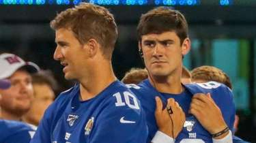 Giants quarterback Eli Manning, left, and quarterback Daniel