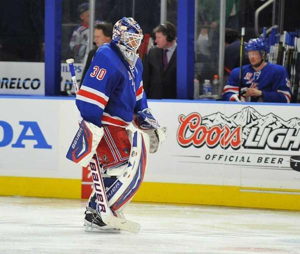 A dejected Henrik Lundqvist skates off the ice