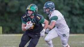 Ward Melville's Jack Gillen #3 catches a pass