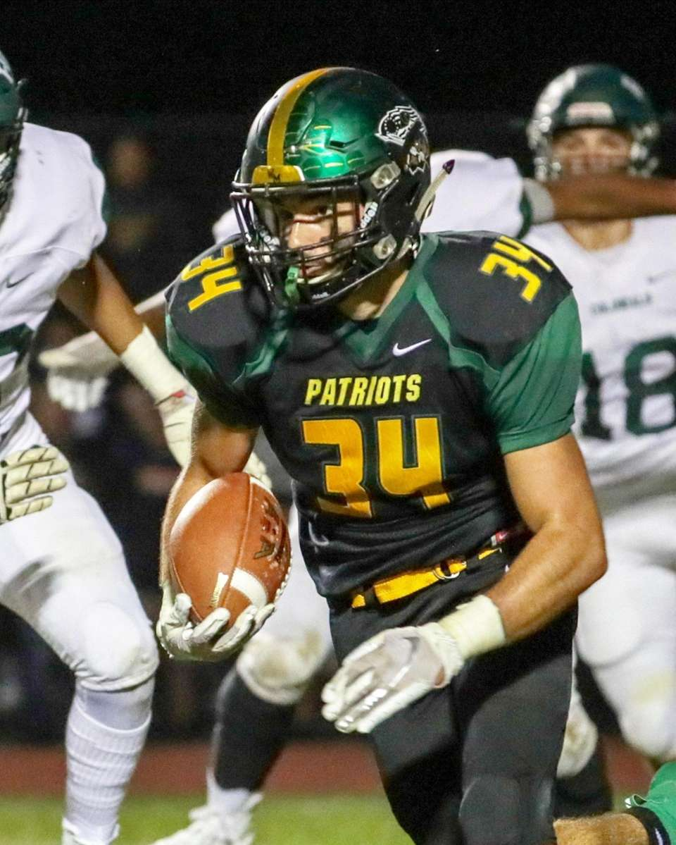 Ward Melville's Michael Fiore #34 carries the ball