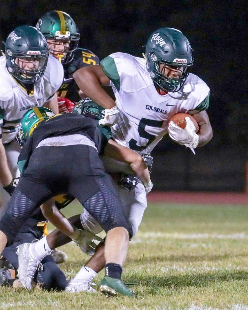 William Floyd's Jezayd Hall #5 carries the ball