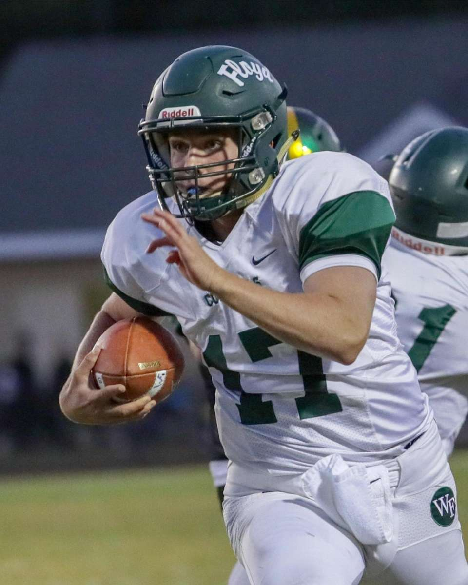 William Floyd's Thomas Verga #17 carries the ball