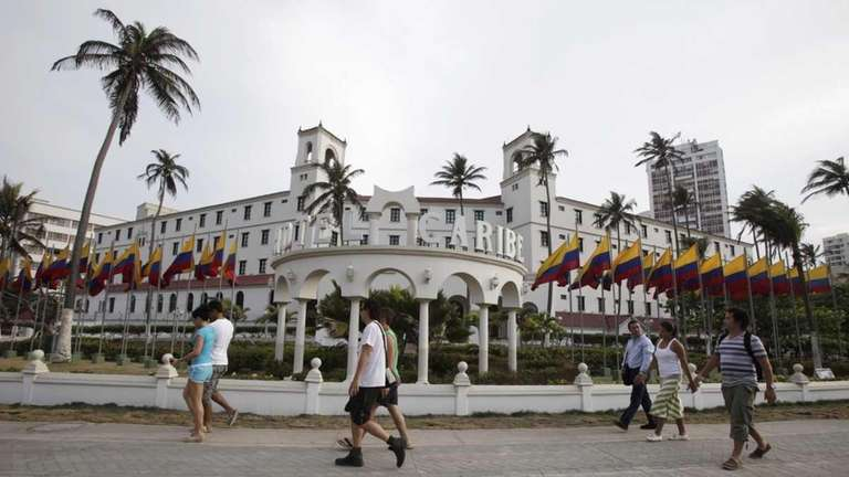 People walk past Hotel El Caribe in Cartagena,