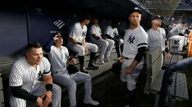 The Yankees wait to take the field for
