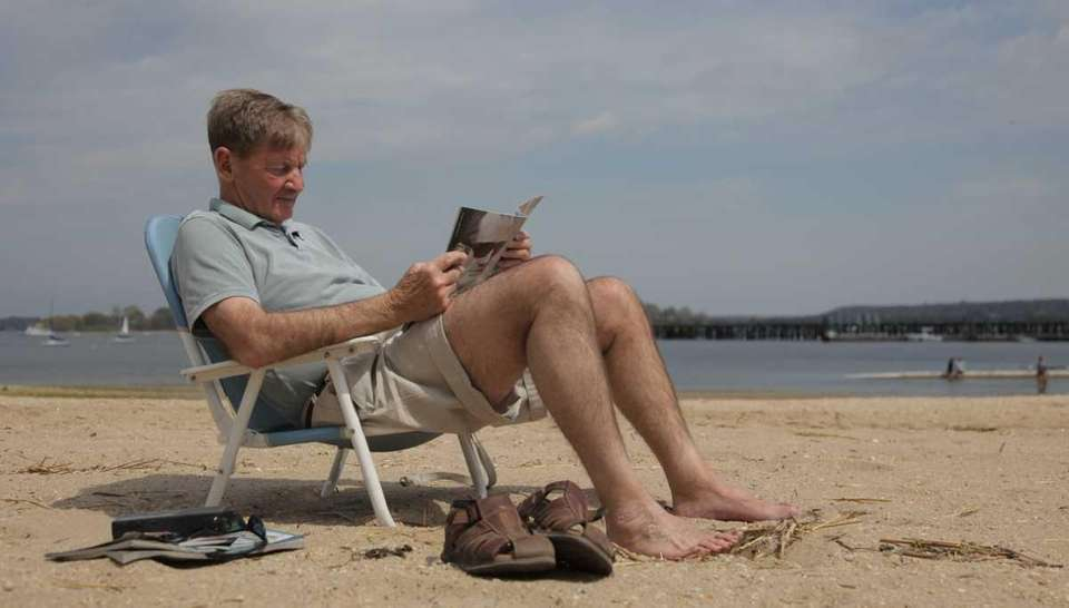 David Gorden, of Oyster Bay, reads a magazine
