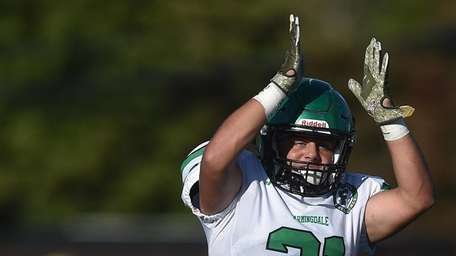 Dominic Ciaccio #21 of Farmingdale reacts after forcing