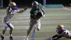 Westhampton Beach's Aidan Cassara (15) run in for