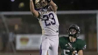 Sayville's Jayson Gensch (23) with the high grab