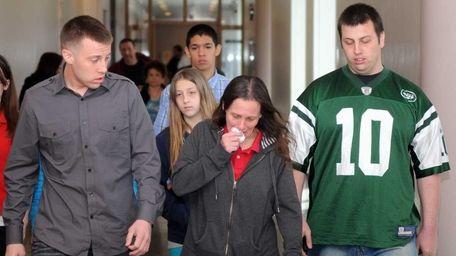 Randi Baumgartner, middle, the mother of victim Ryan