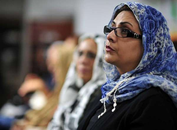 Nazli Chadhry of Commack listens to Dr. Azizah