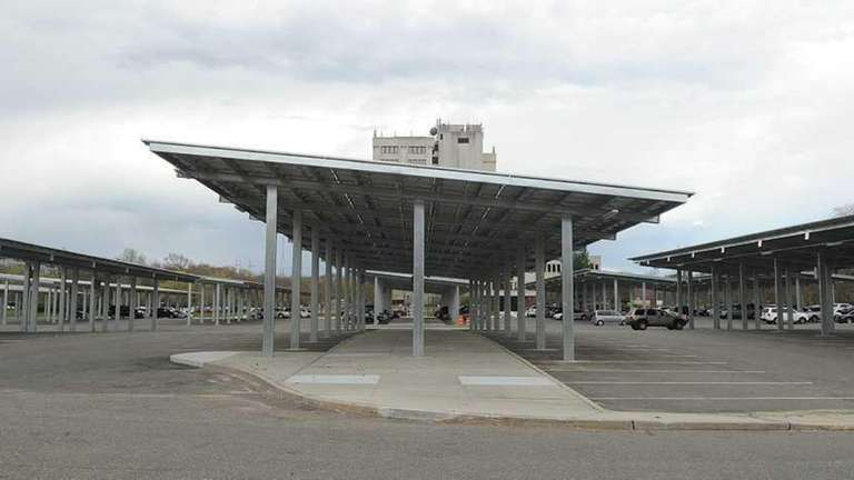 Solar panels installed over carports at the H.