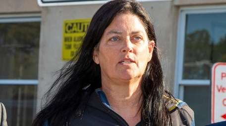 Jennifer Gross is led from Nassau police headquarters