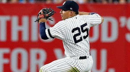 Gleyber Torres of the New York Yankees falls