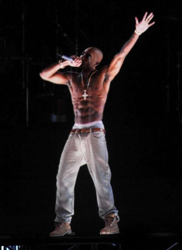 A holographic image of Tupac Shakur is seen