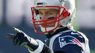 New England Patriots quarterback Tom Brady reacts during