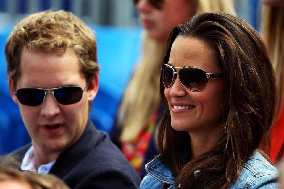 Pippa Middleton watches a tennis match at the