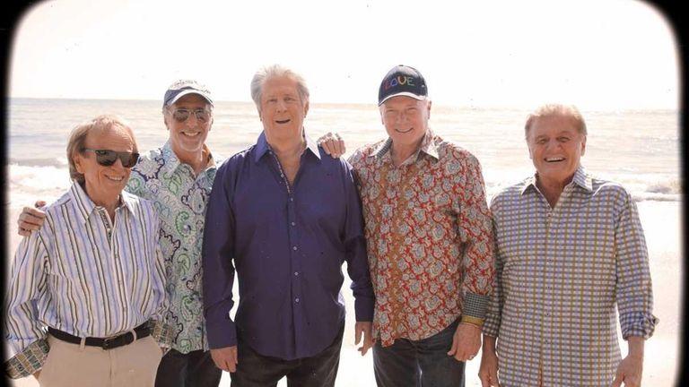 The Beach Boys reunite with Brian Wilson, center,