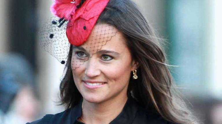 Pippa Middleton attends the wedding of Katie Percy