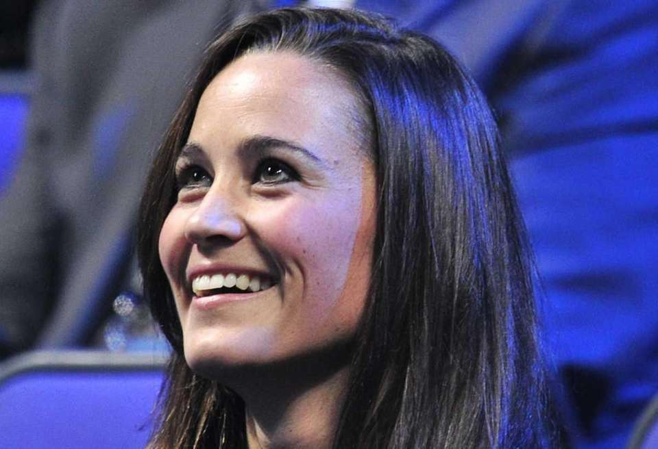 Pippa Middleton watches a match on day eight
