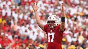 Jack Coan of the Wisconsin Badgers celebrates a