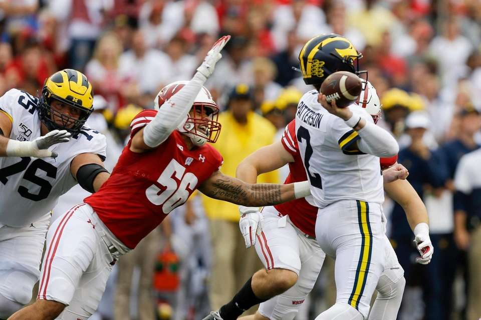 Wisconsin defensive end Rodas Johnson (56) goes after