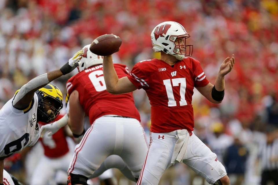 Wisconsin quarterback Jack Coan (17) passes against Michigan