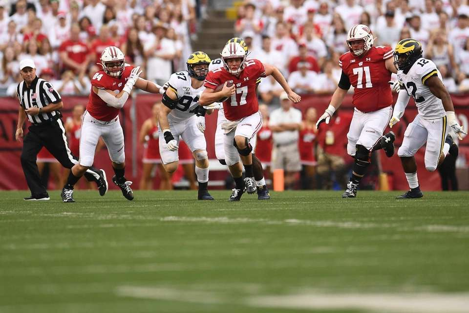 Jack Coan #17 of the Wisconsin Badgers runs