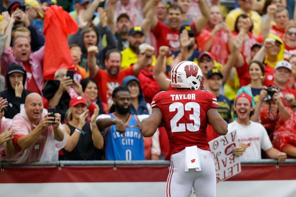 Wisconsin running back Jonathan Taylor celebrates a touchdown