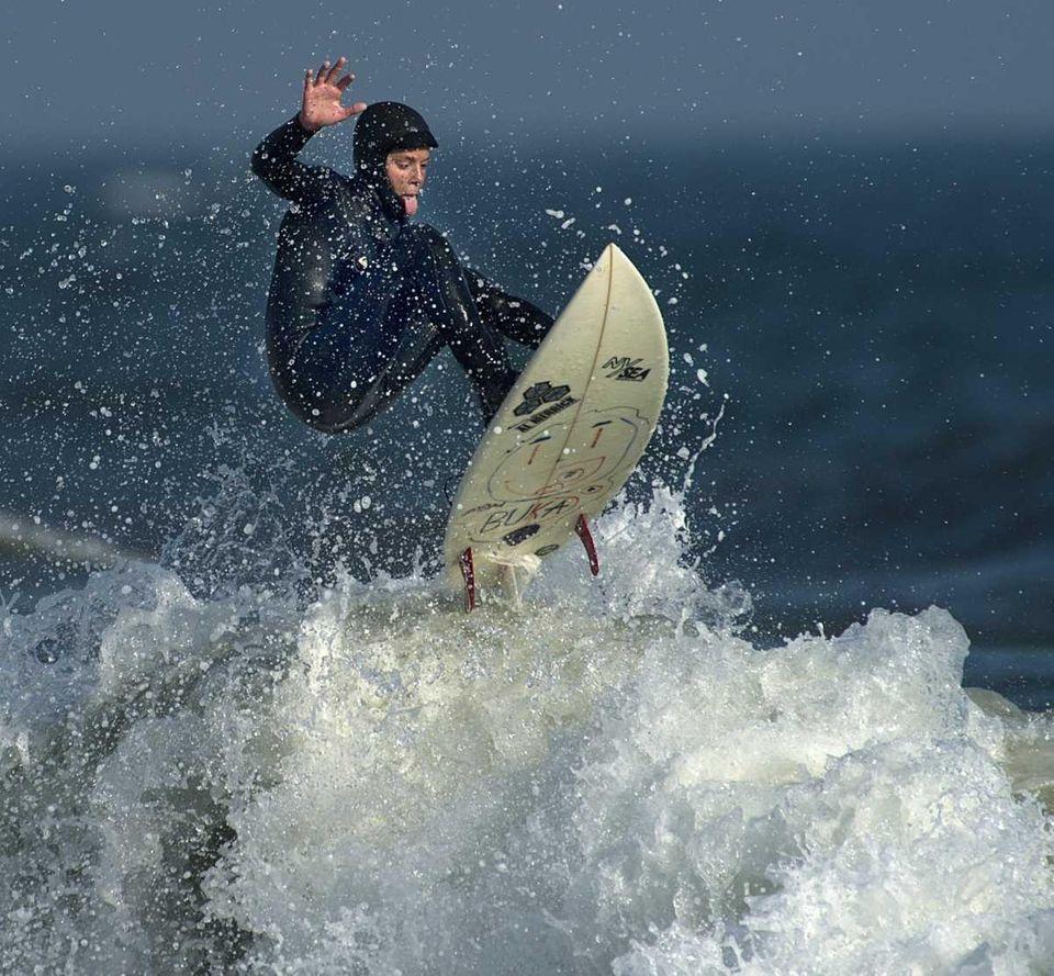 A surfer in Long Beach. (April 16, 2012)