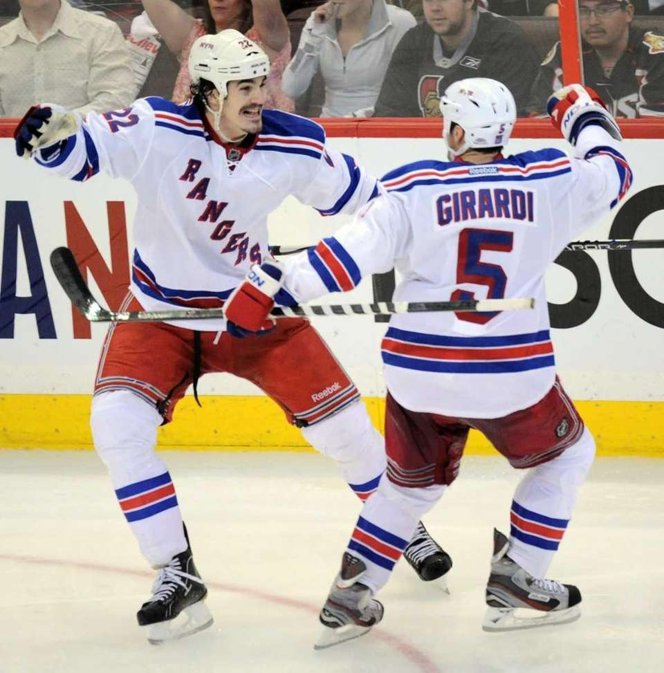 New York Rangers' Brian Boyle, left, skates towards