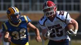 Hugh Kelleher #25, MacArthur running back, right, picks