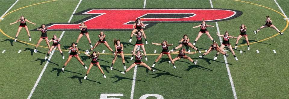 The Plainedge cheerleaders perform at halftime on Sept.