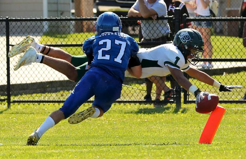 Brentwood RB Kenny Lazo dives down to the