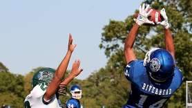Riverhead tight end Isaiah Barbieri makes the leaping
